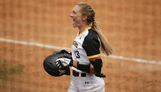 Wichita State and former Wellington Crusader Ryleigh Buck coming into the dugout after scoring a run for the Shockers