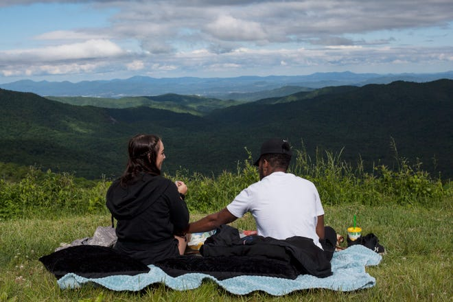 Rose Ivory, left, and Auston Lackey picnic along the Blue Ridge Parkway over the May 30, 2021 Memorial Day weekend.