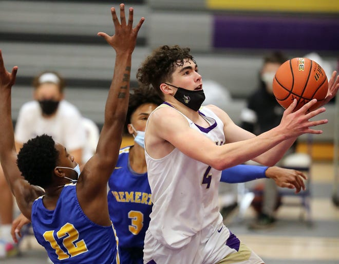 North Kitsap's Jonas La Tour (4) goes up for a layup in between Bremerton's Kanye Taylor (12) and Joseph Wilson (3) during the second half of their game in Poulsbo on Saturday, May 29, 2021.
