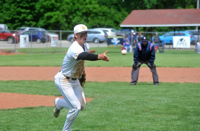 Colonel Crawford's Cade Hamilton flips a ball to first base for the out.