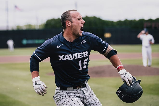 Xavier University catcher Nate Monastra celebrates after hitting a solo home run in the Big East Conference Tournament championship against UConn on Sunday, May 30, 2021 at Prasco Park in Mason, Ohio.