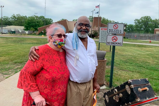 In this photo provided by Bill Proctor, Ray Gray and his wife Barb Gray pose for a photo after he was released from a state prison in Muskegon, Mich., on Tuesday, May 25, 2021. Gray was in prison for 48 years for the fatal shooting of a man in Detroit in 1973. He has long maintained his innocence and provided new evidence in March, 2021. Gray was not exonerated, but prosecutors agreed to drop the conviction in exchange for a no-contest plea to second-degree murder. He was sentenced to time served.