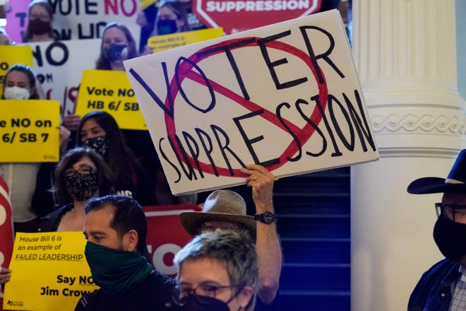 In this May 6, 2021 file photo, a group opposing new voter legislation gather outside the House Chamber at the Texas Capitol in Austin, Texas.