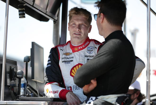 Team Penske drivers Josef Newgarden (2)  and Will Power (12) talk Sunday, May 30, 2021, after the 105th running of the Indianapolis 500 at Indianapolis Motor Speedway.