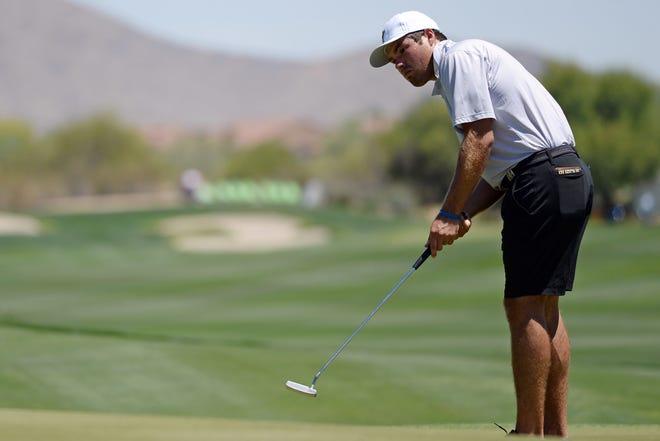 May 29, 2021; Scottsdale, Arizona, USA; Purdue University golfer Cole Bradley putts on the tenth green during the NCAA Men's Golf Championship at Grayhawk Golf Club. Mandatory Credit: Joe Camporeale-USA TODAY Sports
