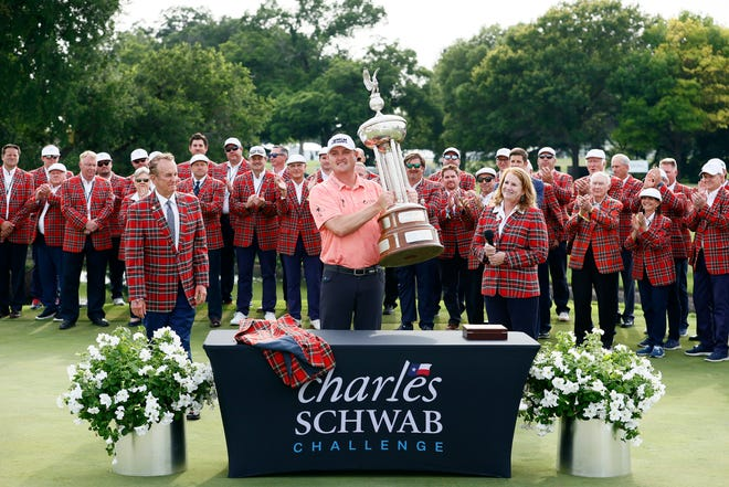 Jason Kokrak celebrates with the Leonard Trophy after winning the 2021 Charles Schwab Challenge at Colonial Country Club in Fort Worth, Texas.