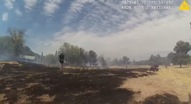 An 11-year-old boy was facing three felony charges after Yavapai County Sheriff's Office officials said he intentionally started a fire at an old golf course in northern Arizona.  A video still from the Sheriff's Office shows damage from the fire that started on May 22, 2021.