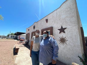 Patricia Pagliuca (left), and Teresa Mabry (right) stand in front of the RE:FRAME Youth Center during a Rights Restoration Clinic.