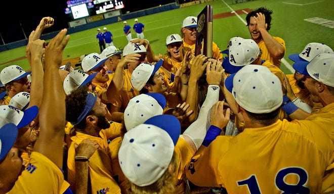 Members of the Angelo State University baseball team celebrate winning the NCAA Division II South Central Regional championship over West Texas A&M University on Saturday, May 29, 2021.