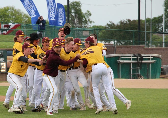Harrisburg players celebrate winning the high school baseball state championship Saturday at the Birdcage.