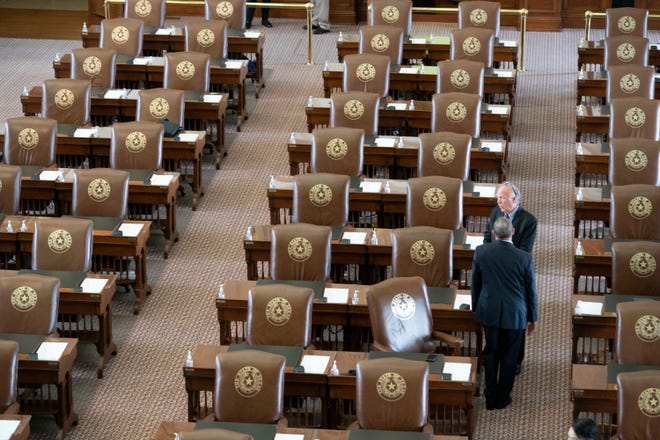 State Rep. Todd Hunter, R-Corpus Christi, talks with a colleague as the House gathers late for Sine Die on the final day of the 87th Texas Legislature.