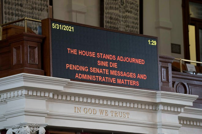The electronic sign over the Speaker's podium shows the House stands Sine Die on the final day of the 87th Texas Legislature.
