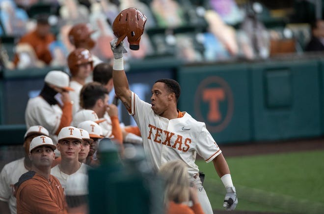 Texas infielder Cam Williams acknowledges fans after hitting a home run against Texas Southern in Austin on May 11. Texas has earned the No. 2 overall seed in the NCAA Tournament, which begins this week with the Austin Regional.