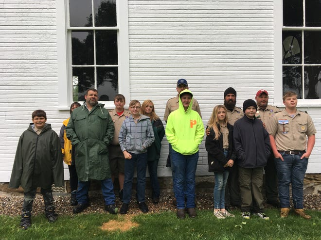 Members of Boy Scout Troop 150 of Minerva took part in an event to place flags on veterans' graves at Moultrie Chapel. On hand were Luke, Kyle and Loretta Somers; Lucas and Don Hester; Alex, Ellie and Corey Kuttie; Vern and Zeb Snyder; Mitchell, Wendy and Rob Tabellion.