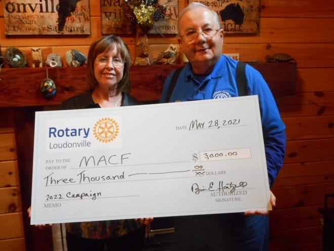 Rotary President Brian Hartzell presents an oversized check for $3,000 to Mohican Area Community Fund President Jane Stoops. Money was raised through fundraisers and a $1,000 match from Rotary District 6600.