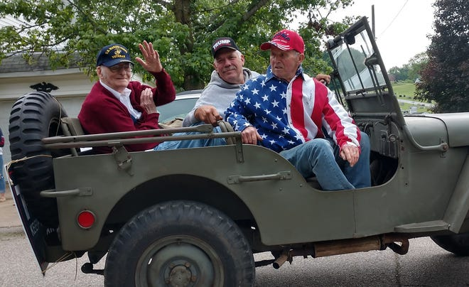 World War II Marine veteran Wayne Heffelfinger (left) rides with his nephew, Doug Heffelfinger, and friend Larry Harris during Monday's Loudonville Memorial Day Parade. Heffelfinger, 99, served in the Pacific Theater, including the landing at Tarawa, and remembers being inspected by Gen. Douglas MacArthur.