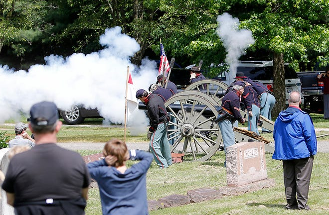 Battery D fires the canons at the Ashland Memorial Day service at the Ashland Cemetery on Monday. A United States10-pounder Parrott rifle was dedicated in honor of Battery D. It is located at the cemetery next to the gazebo. TOM E. PUSKAR/TIMES-GAZETTE.COM