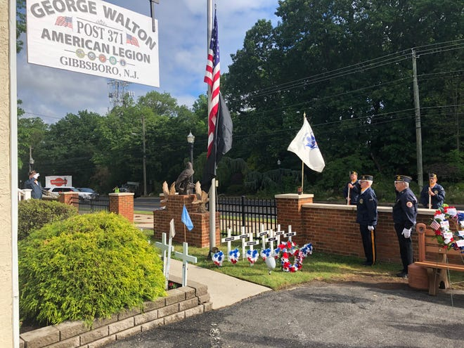 Wreaths and crosses engraved with the names of residents who lost their lives while serving in the U.S. armed forces are placed in front of the American Legion George Walton Post 371 each Memorial Day.