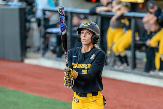 Missouri's Cayla Kessinger (33) looks at her bat before stepping in the batter's box during a super regional game against James Madison.