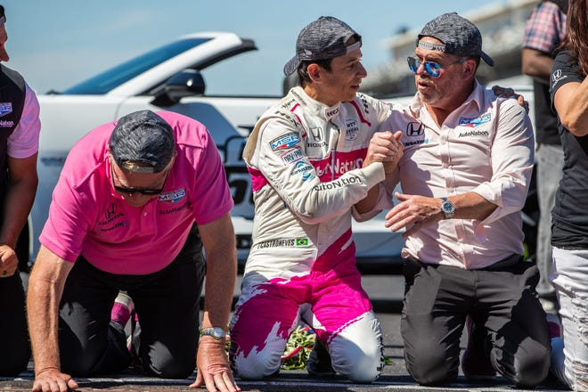 Helio Castroneves celebrates with team owners Mike Shank, right, and Jim Meyer after winning the Indianapolis 500 on Sunday. Shank is a 1985 Gahanna graduate, and his racing team is based in Pataskala.