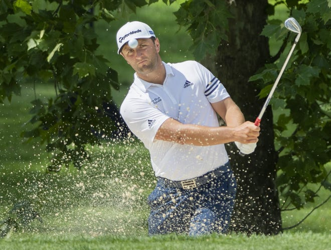 Jon Rahm hits out of a bunker en route to winning last year's Memorial Tournament. The victory moved him atop the world rankings, only the fifth player to reach No. 1 before turning 26.