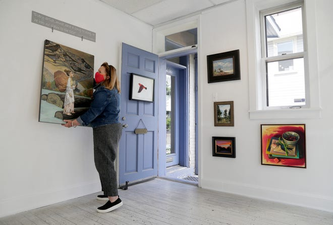 Sharon Weiss, the owner of Sharon Weiss Gallery in the Short North, prepares for customers over the weekend.
