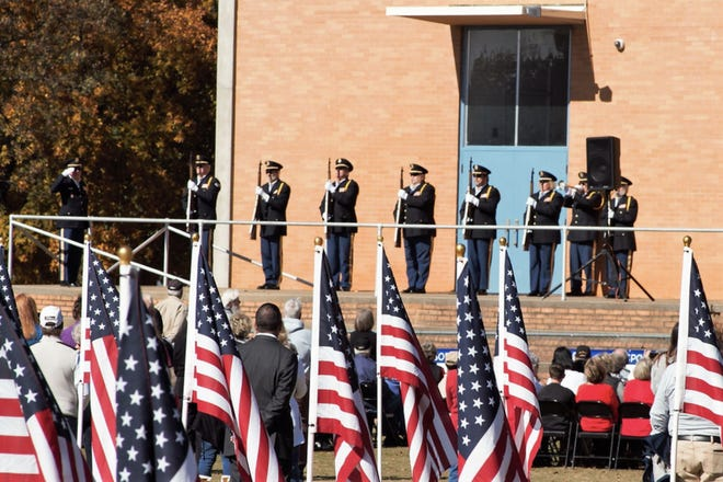 Randolph County Honor Guard performs a rifle volley in honor of fallen service members.
