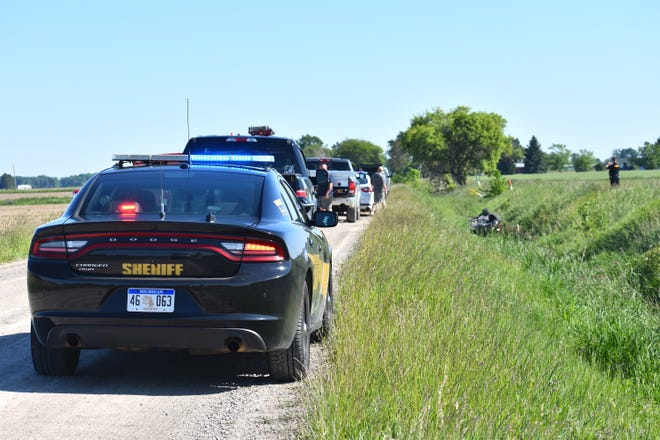 A Lenawee County Sheriff's Office patrol car and other emergency vehicles line Lipp Highway in Riga Township Sunday while responding to a single-vehicle crash that killed a 78-year-old passenger from Blissfield and sent the 48-year-old driver, also from Blissfield, to the hospital. Deputies reported the driver lost control of the car on the gravel roadway, causing it to go off the road and into a large ditch.