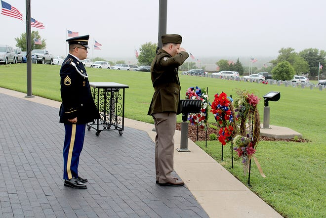 SSG Victor Soto and SSG Daniel Rivera US Army do the Placing of Wreaths in memory of the Tomb of the Unknowns and all our fallen heroes as part of the Memorial Day Ceremony at Kansas Veteran's Cemetery at Fort Dodge on Monday.
