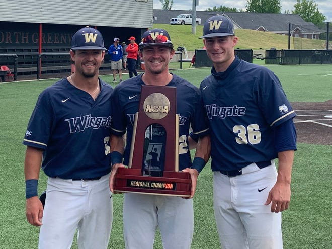 Wingate baseball players (from left) Carson Simpson, Jed Bryant and Brody McCullough pose with the NCAA Division II Southeast Regional championship trophy on Sunday. [Contributed photo]