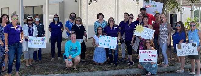 The teachers and staff of iFlagler held a drive-thru awards day for virtual education students.