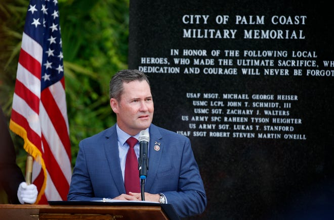 Congressman Michael Waltz, shown at a Memorial Day ceremony in Palm Coast, faced a series of questions by a retired U.S. Army lieutenant general, Mark Hertling, who recently moved to Flagler Beach.
