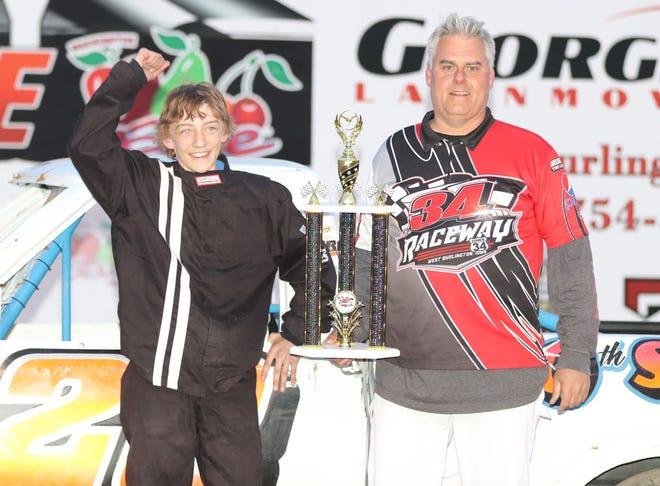 Fourteen year old Tucker Richardson, Morning Sun, celebrates  his first mini-hauler feature at 34 Raceway Sunday night.