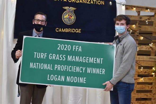 At the Cambridge FFA awards program on Saturday, April 24, advisor Trent Taber, left, recognized Logan Nodine as the 2020 national winner in turf grass management.