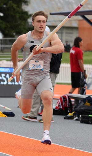 Will Daniels, representing the University of Iowa, in competing in the pole vault portion of the decathlon.