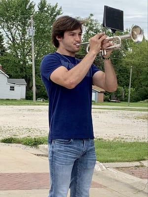 Lucas Kessinger playing taps