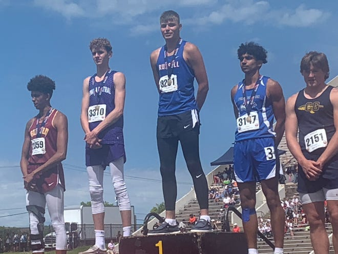 Russell's Jace Peerman, middle, won the Class 3A high jump title.