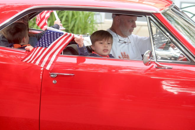 A child waves a flag during the Saugatuck Memorial Day Parade on Monday, May 31, 2021, in Saugatuck, Mich.
