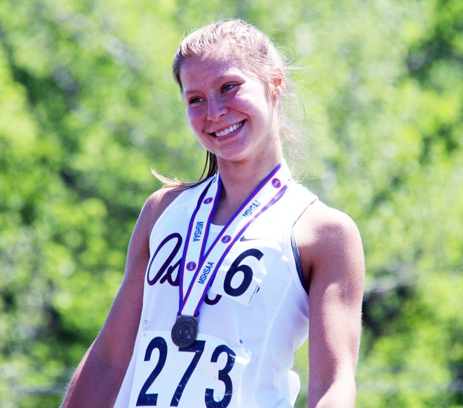 Osage senior Sara Wolf is all smiles on top of the podium as the Class 3 state champion in the 1,600-meter run on May 29 at Adkins Stadium in Jefferson City.