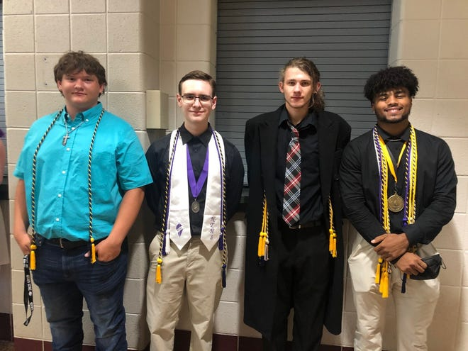 Engineering students Naylin Cook, Trenton Burns, Corey Annable and Draetius Allen await the start of graduation ceremonies for the Mineral County Technical Center. Graduation was held in the Keyser High School gym Friday.