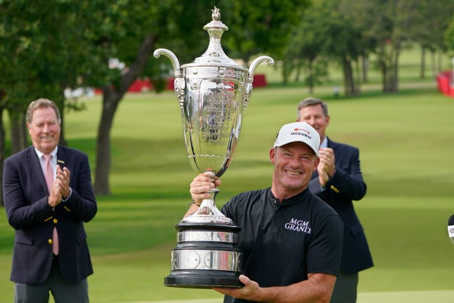 Alex Cejka holds the Alfred S. Bourne Trophy after winning the Senior PGA Championship on Sunday at Southern Hills in Tulsa.