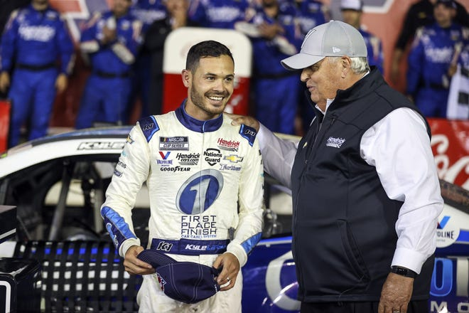 Car owner Rick Hendrick, right, congratulates Kyle Larson in victory lane after Larson won the Coca-Cola 600 Sunday night  at Charlotte Motor Speedway in Concord, N.C.