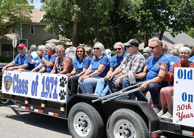 Some members of the St. John High School Class of 1971 rode on a float in the 2021 Jubilee parade, part of their 50th class reunion celebrations, while others walked behind.