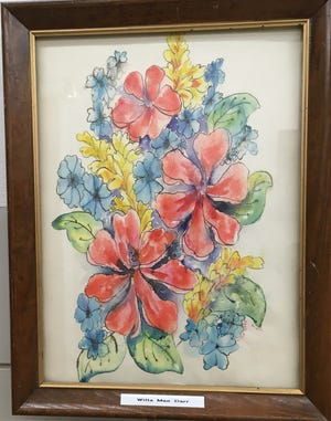 A painting by Willa Mae Darr brightens the hall way of Stafford County Hospital, along with several other pieces of artwork now on loan for public viewing.