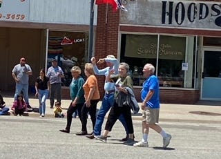 St. John High School class of 1961 members walking in the St. John Jubilee parade included (from left): Linda (Clowers) Broadfoot, Diana Seitz (Francis), Jim Dale, Ann (Waters) Weaver and David McCandless. They were in town celebrating their 50th class reunion.