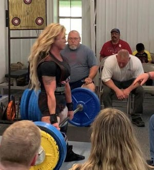 Misty Rendleman, of the Crain's Muscle World team, sets a state and national masters record with a 400-pound deadlift in the women's masters division, 132 pound-class at the 2021 USPF 57th Oklahoma State Powerlifting Championships at Crain's Muscle World in Shawnee.