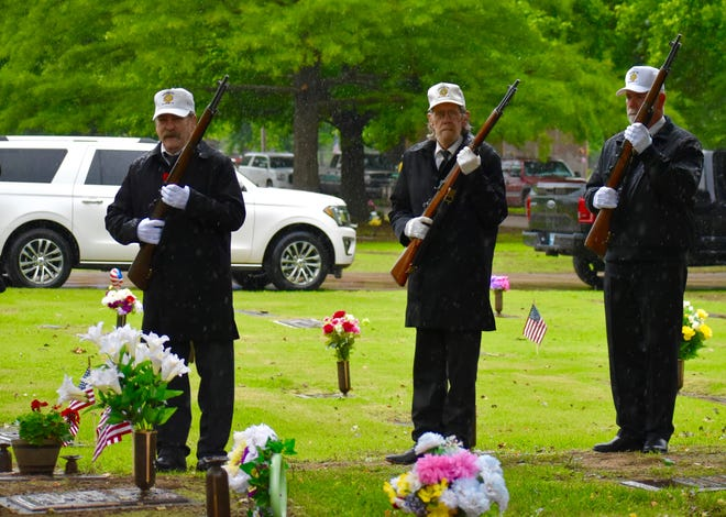 The Veterans of Foreign Affairs Honor Guard gives a 21-gun salute during Monday's Memorial Day service.