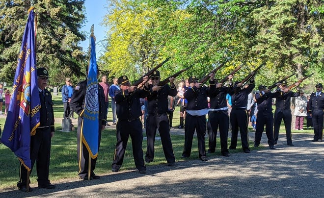 The color guard offers a 21-gun salute during the Memorial Day service at Sacred Heart Secretary in Aberdeen Monday morning.