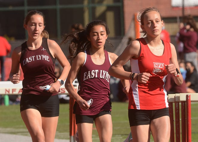 NFA's Eliana Duclos wins a 1600 meter race against East Lyme's Kennedy Holsapple and Izzy Paggioli, left, during a meet earlier this season in Norwich.