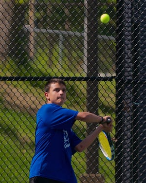 West Boylston's Aaron Nano concentrates on a two-handed backhand during the 2019 season.
